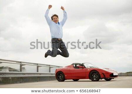 Man springen gelukkig elektrische auto reizen succes Stockfoto © IS2