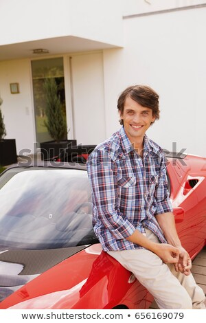 Man sitting proudly on his electric car Stock photo © IS2