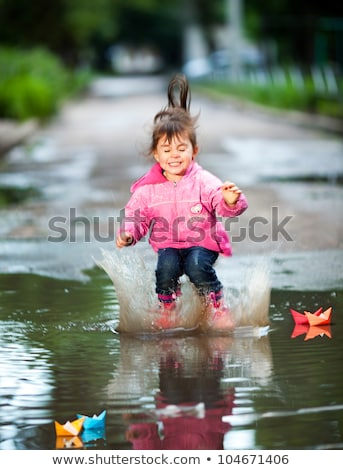 Girl wearing colorful rainboots Stock photo © IS2