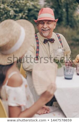 женщину · сидят · забор · улице · улыбающаяся · женщина · улыбаясь - Сток-фото © is2