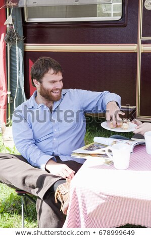 Man picnicking outside trailer Stock photo © IS2