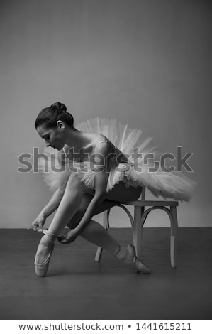girl tying the ribbons on her ballet slippers stock photo © is2
