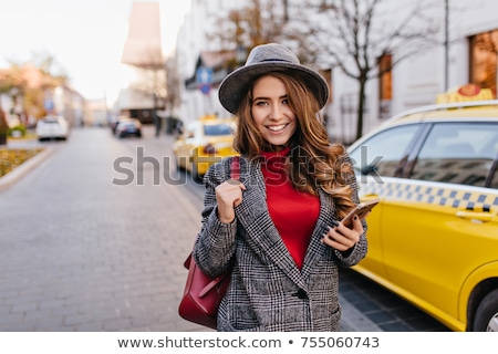 Portrait of woman in taxi Stock photo © IS2