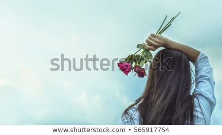 portrait of a charming lady holding a bouquet of roses stock photo © konradbak
