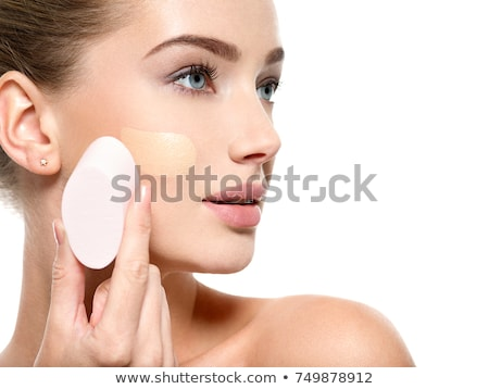 girl applying foundation on face isolated on white Stock photo © svetography