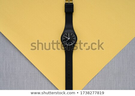 set of mechanical clock hands on a gray background with copy space flat lay stock photo © artjazz