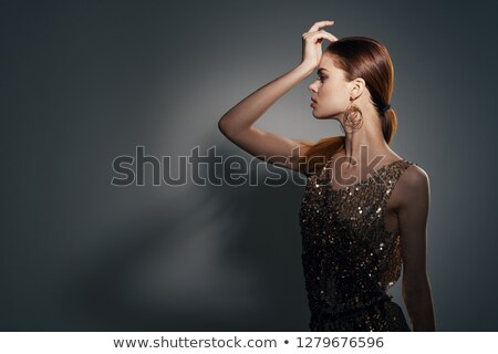 a womans hand holds bright christmas lights on a black background with space for text christmas stock photo © artjazz