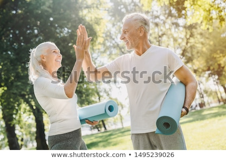 Senior woman and man running or jogging on a field Stock photo © Kzenon