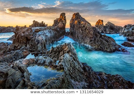 Rocky pillars formed by nature channelling the tidal flows Stock photo © lovleah