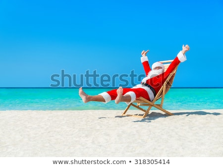 Сток-фото: Merry Christmas Santa Claus Resting On Islands