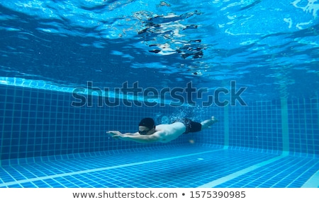 man at the bottom of the pool, he dives under the water Stock photo © galitskaya