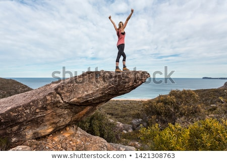 Hiker in national park arms outstretched feel on top of the world Stock photo © lovleah