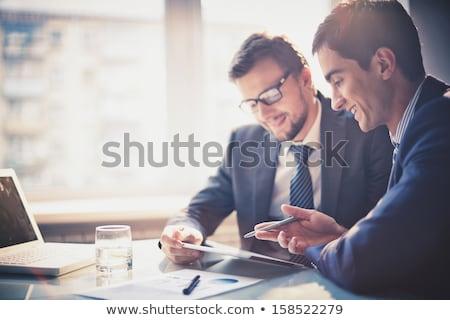 Touchpad jeunes employé lunettes puce parler Photo stock © pressmaster