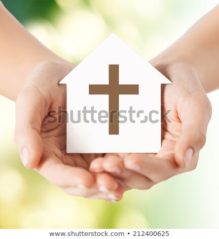 Hands Holding Paper With Cutout Religion Symbols Stock photo © AndreyPopov