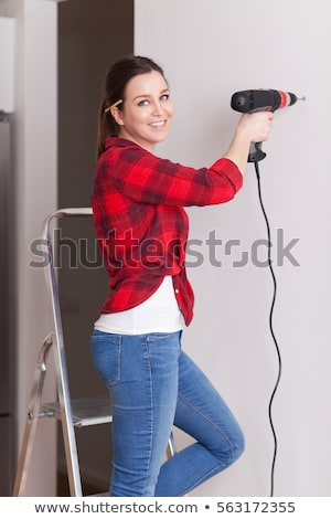 Portret vrouwelijke timmerman boor machine Stockfoto © wavebreak_media