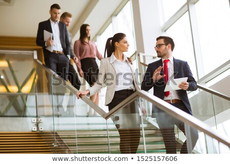 Business partners analyze the business results while walking dow Stock photo © boggy