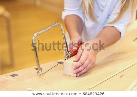 Genç öğrenci öğrenme testere ahşap öğretmen Stok fotoğraf © vystek