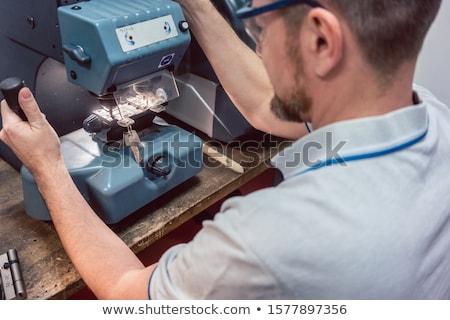 Cerrajero clave máquina experto hombre Foto stock © Kzenon