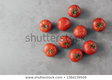 Delicious red tomatoes for making ketchup on grey background. Vegetables covered with water drops. F Stock photo © vkstudio