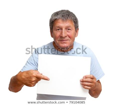 Eccentric man pointng on the empty board Stock photo © konradbak