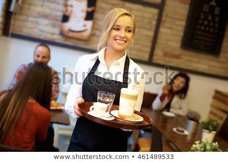 Happy Young Waiter Stock photo © Kurhan