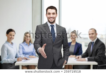 The businessman gives a hand to greet Stock photo © goryhater