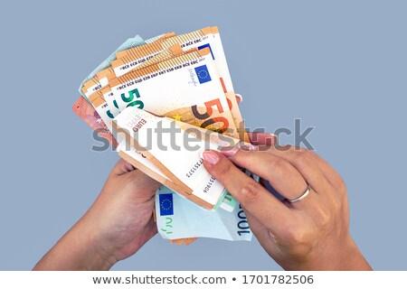 nő · tart · valuta · jegyzetek · női · igazgató - stock fotó © photography33