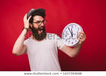 Shocked worker watching alarm clock Stock photo © photography33