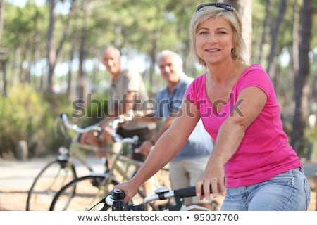 Stock photo: group of seniors riding bikes in the park
