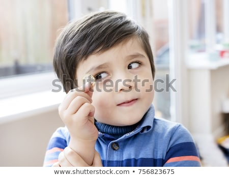 Little boy holding coins Stock photo © photography33