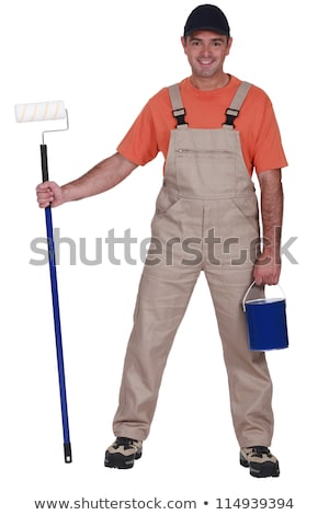decorator holding a paint roller with long extension stock photo © photography33