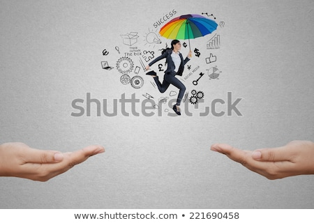 Woman jumping with keys in hand Stock photo © photography33