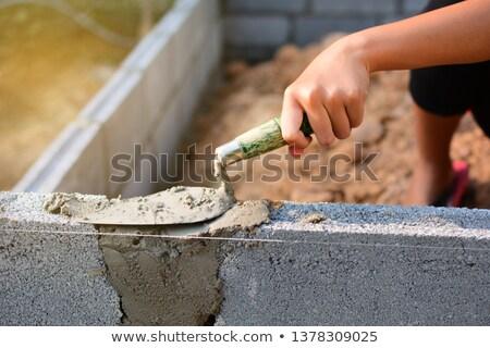 Man and woman masons stacking bricks Stock photo © photography33