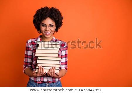 Stock photo: Young woman with a pile of books in her arms