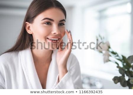 attractive woman applying skin cream stock photo © photography33