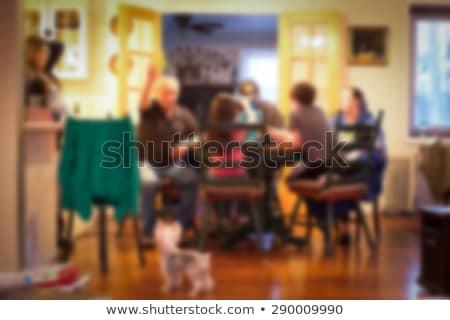 Family gathered around kitchen table Stock photo © photography33