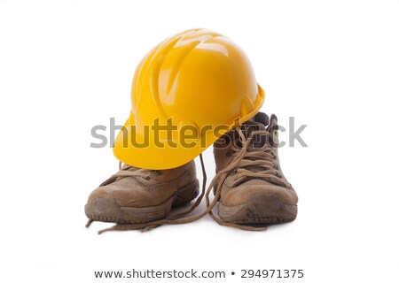 Yellow hard hat and old boots Stock photo © stevanovicigor