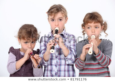 three young girls playing the recorder stock photo © photography33