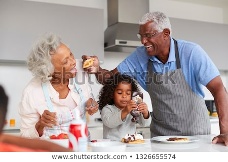 Woman and child making pancakes Stock photo © photography33