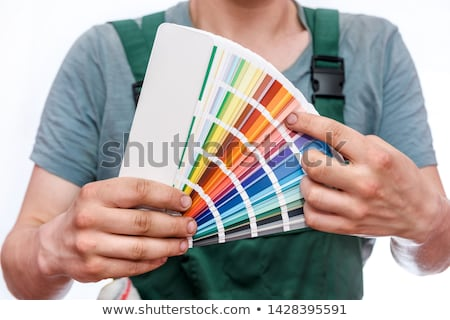 Male decorator holding paint swatch Stock photo © photography33