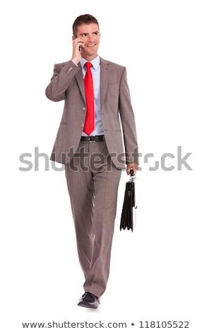 caminhada · para · a · frente · falante · telefone · homem · de · negócios · olhando - foto stock © feedough