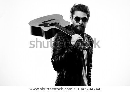 Handsome casual man with guitar on shoulders Stock photo © stockyimages