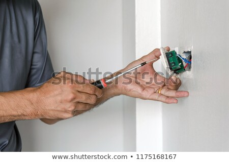 Electrician fixing an outlet Stock photo © photography33