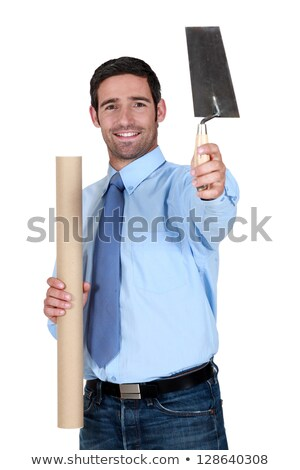 Engineer holding a trowel and a rolled-up drawing Stock photo © photography33