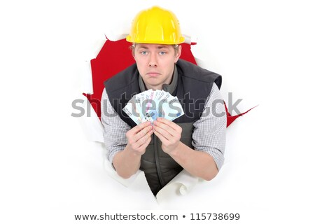 Laborer showing wad of bills Stock photo © photography33