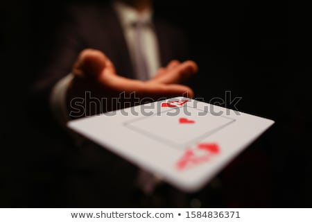 Card player throwing in his hand Stock photo © sumners
