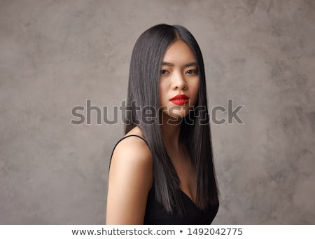 elegant brunette girl posing in red gorgeous dress isolated on w stock photo © victoria_andreas