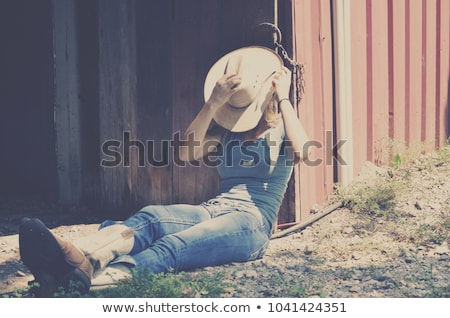 Cowgirl Relaxes Stock photo © cboswell
