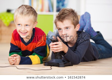 Two little boys enjoying their childhood Stock photo © konradbak