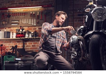 Man kneeling by motor bike Stock photo © photography33